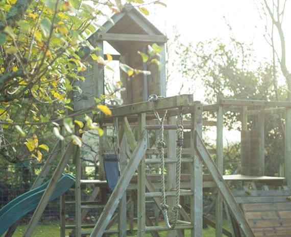 Outside wooden climbing frame in the garden