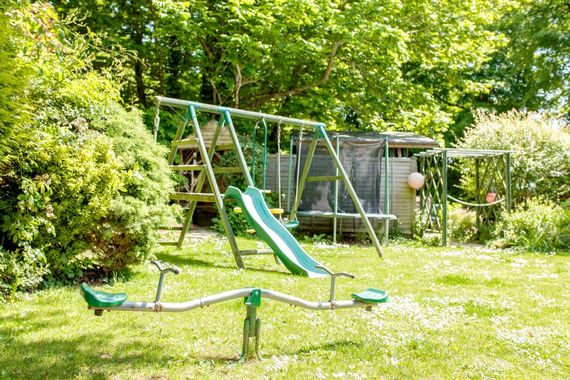 Have fun on the trampoline and play equipment on the lovely lawned areas