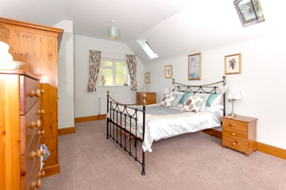 The main bedroom can easily accommodate two cots