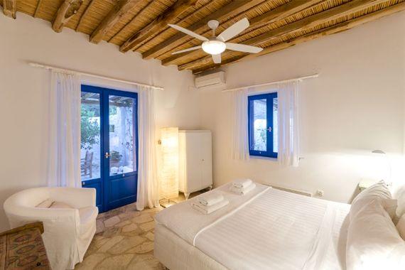 Guest bedroom with queen bed and side terrace doors