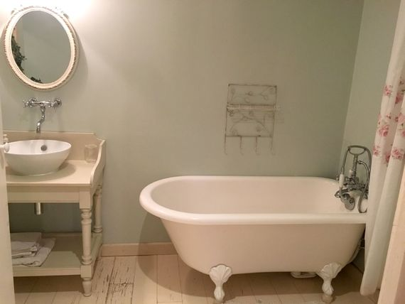 En suite bathroom with bath and shower cubicle