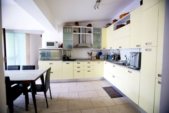 Large kitchen with quality appliances and utensils.