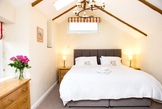 Beautiful second bedroom with vaulted ceiling.  Bed can be either a double or twin
