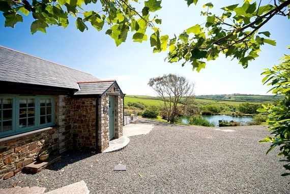 View of The Stables cottage with duck pond in the background