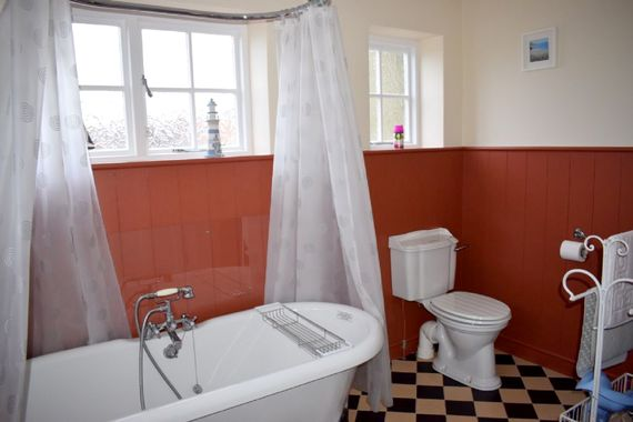 Newly decorated bathroom with roll top bath