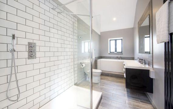 Stylish bathroom with shower and bath tub