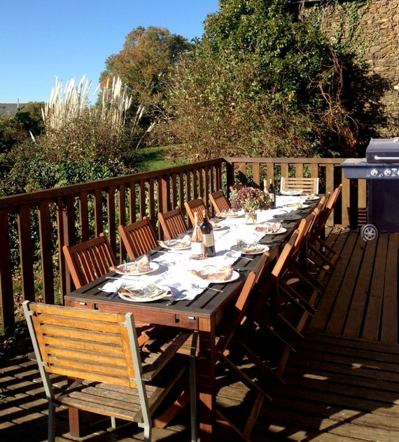 Enjoy a barbecue lunch on the wrap-round deck of the farmhouse.