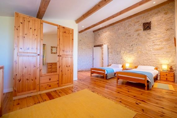 Petit Chateau upstairs twin bedroom with en-suite