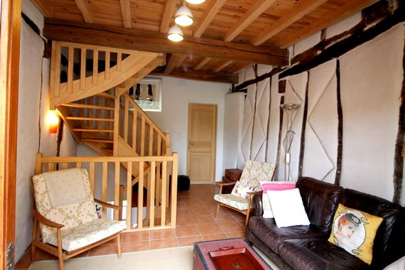 Comfy 1st floor salon that leads to the private terrace with lovely views across the fields and hills