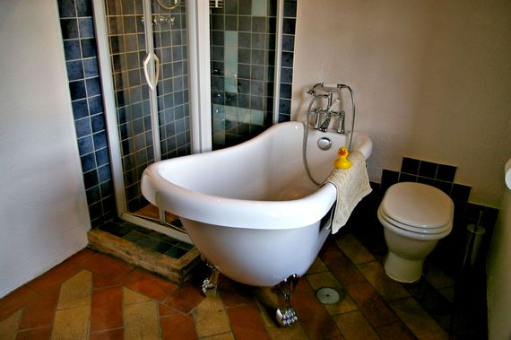 Bathroom with roll top bath
