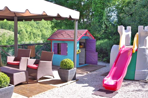 Play area and wendy house by the pool