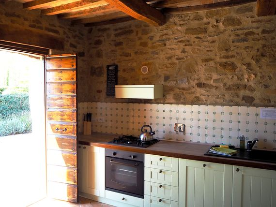 DOUBLE DOORS IN KITCHEN OPEN TO TERRACE