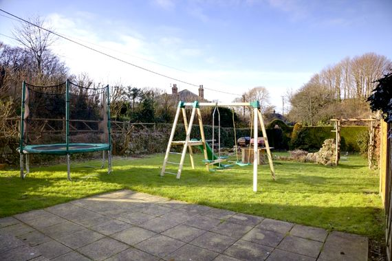 Garden with play frames and trampoline