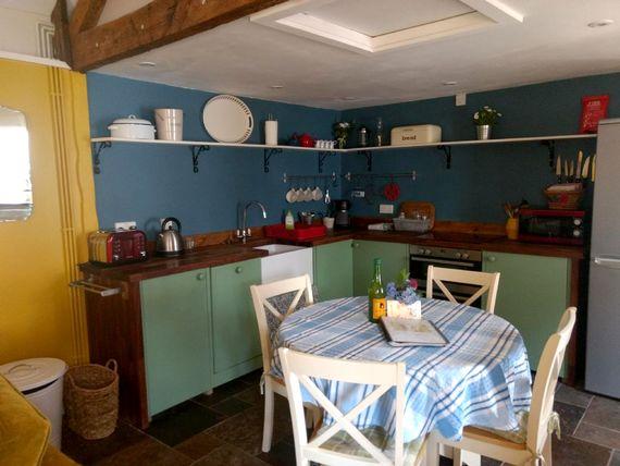 The open plan kitchen has fridge/freezer, dishwasher, microwave, double oven, coffee machine etc, plus child friendly crockery