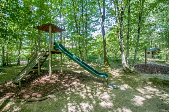 Shady playground in the woods