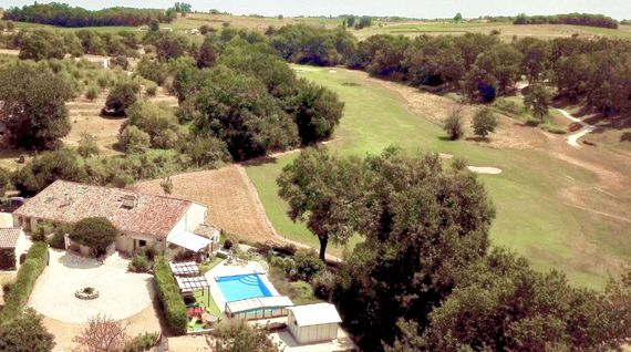 Aerial view of the villa showing the super views over the golf course, vines and woodlands