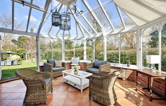 From the conservatory, parents can keep an eye on the children as they enjoy the fenced garden
