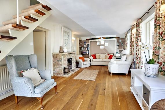 The sitting room with open fire for cooler months