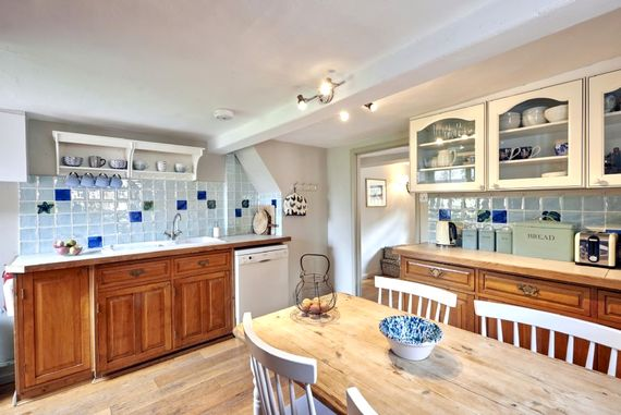 The kitchen features a dishwasher as well as a microwave and oven