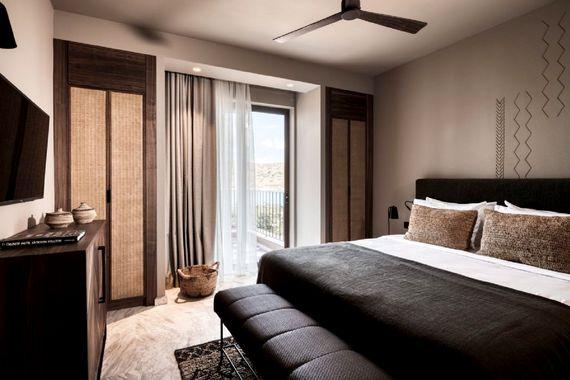 Domes of Elounda-Premium Suite Garden View Image 4