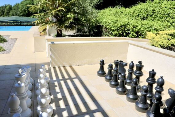 Families love the giant chess next to the pool!