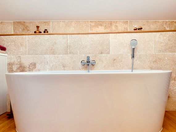 The Barn bedrooms share a bathroom with large Sottini bath and Grohe fittings