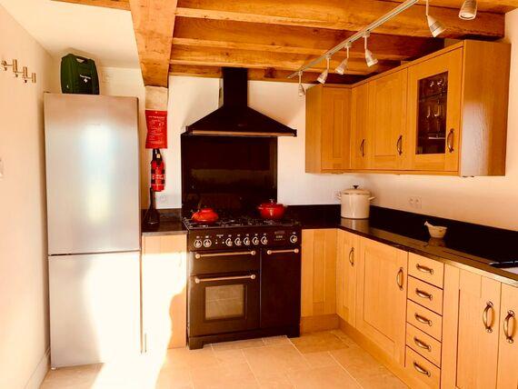 The Barn kitchen with large Range master stove, Bosch fridge freezer, Le Creuset, Joseph Joseph