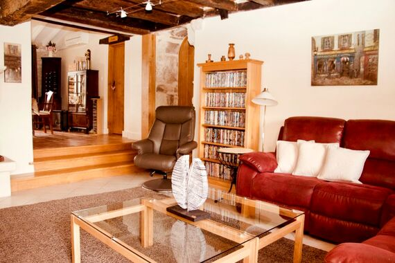 The Farmhouse sitting room is linked to The Barn sitting room via an ancient oak door next to the DVDs.