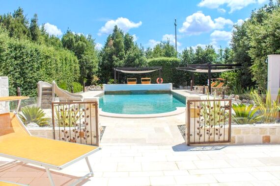 Pool with gate and glass fence.