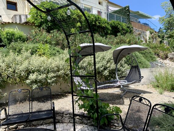 The Lower Garden has a dining area and hammocks