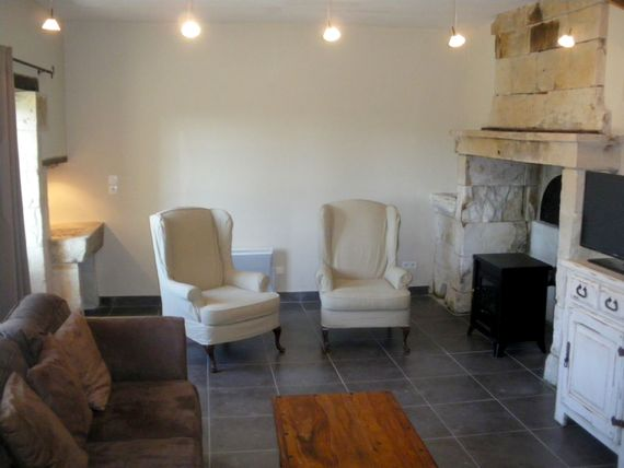 Boulangerie sitting room by the fireplace