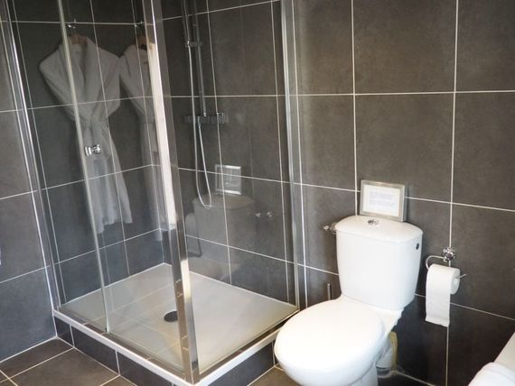parents' ensuite shower, bath, WC and basin