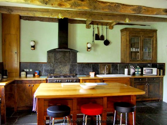 The Kitchen, rustic in design, is fully equipped with all modern conveniences.
