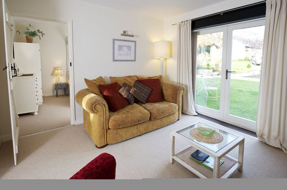 Lounge with french doors opening onto garden