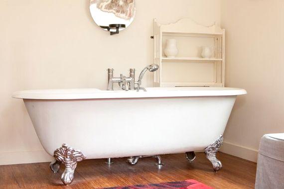 Roll top bath in master bedroom