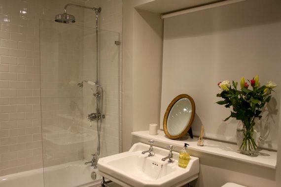 Second bathroom with bath and rain-shower