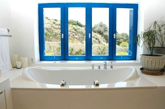 Soaking tub with views in master bathroom