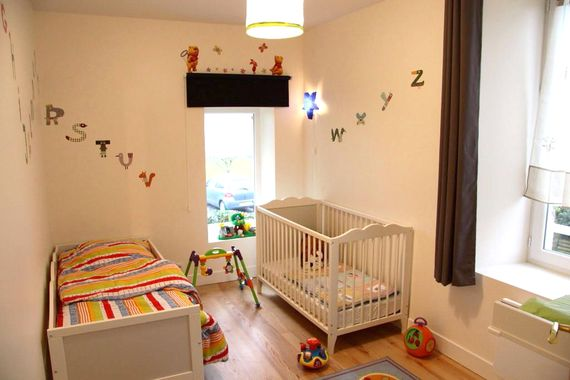 Spacious nursery with cot, toddler bed and change table