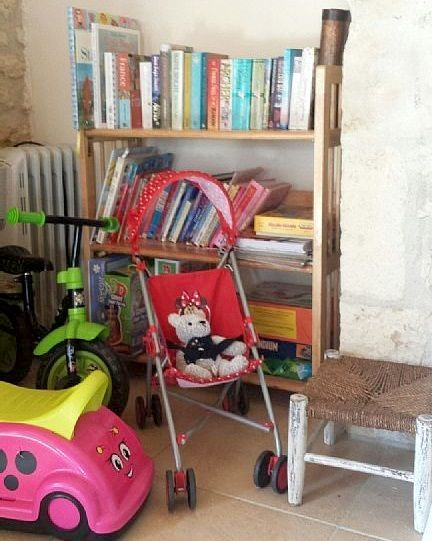 Kids corner....with ride on toys, books, games, dvds, drawing paper and crayons