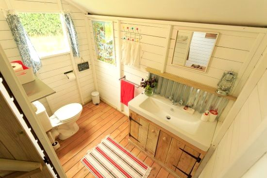The bathroom is inside the tent