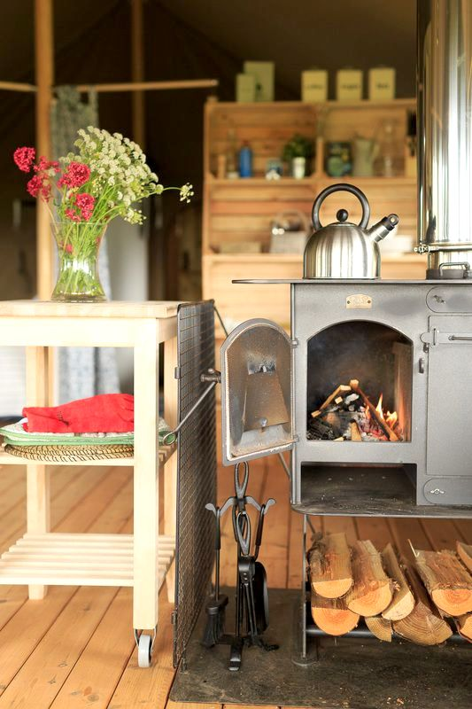 Cooking is on a wood stove with a large hob top and oven.