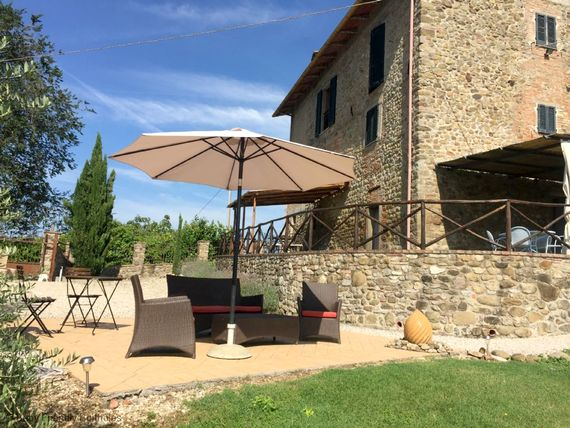 Villa Bastiola with sun terrace and two loggias both with tables and chairs