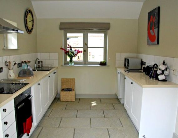 Well equipped kitchen with dishwasher and microwave