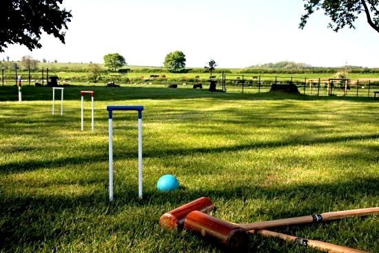 Family games on the extensive farmhouse lawn