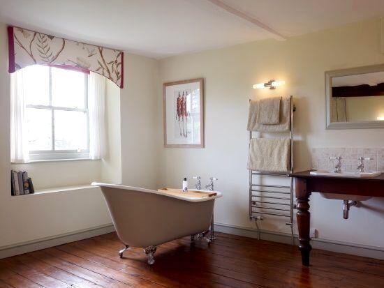 Slipper baths in three bedrooms