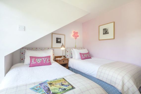 Twin bedroom with book for children as gift
