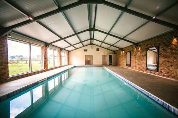 Indoor biomass heated swimming pool