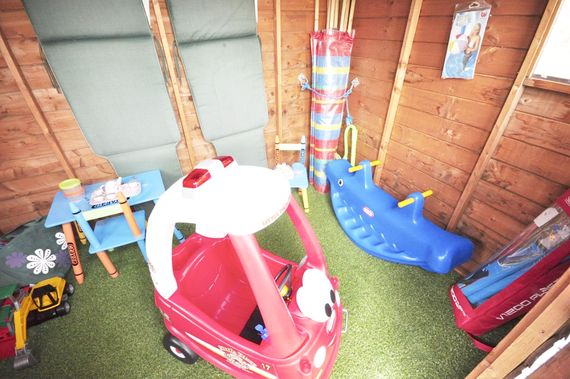 Garden shed with games and toys for the kids