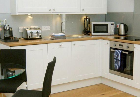Kitchen with nespresso machine.