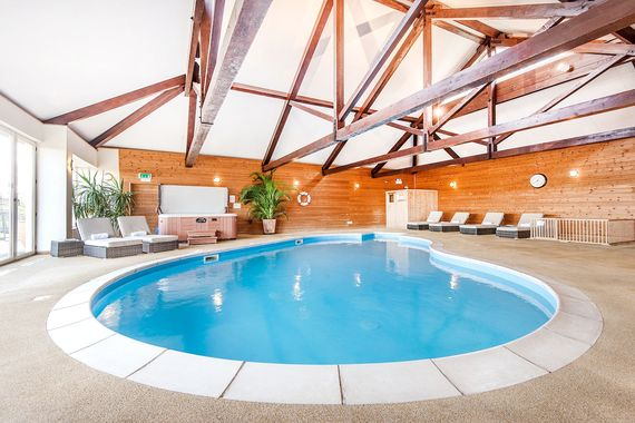Clydey heated pool area with baby safety pen, hot tub and sauna